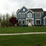 Beautiful lawn in front of house by Bison Bluegrass