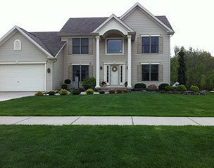 House with a beautiful & maintained lawn